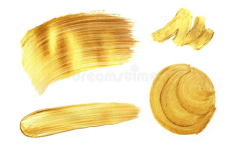 Set of golden paint strokes, isolated on white. royalty free stock photos