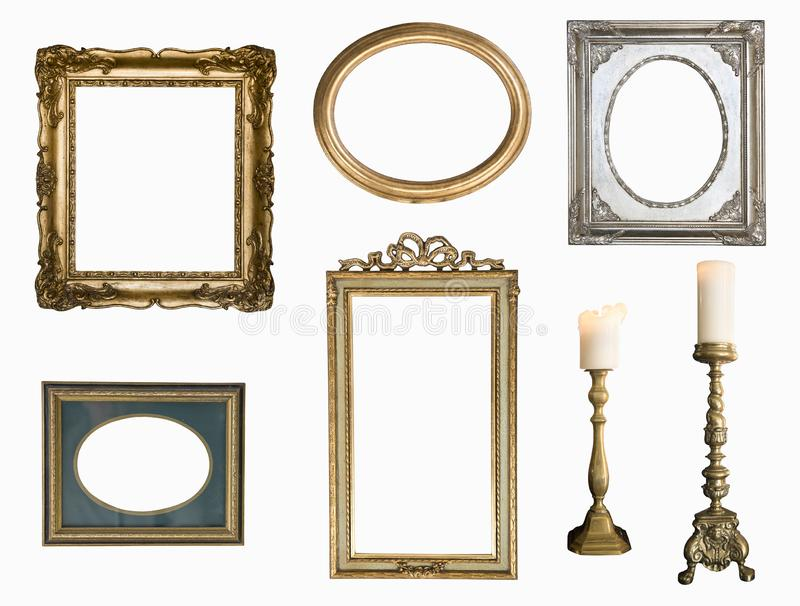 Set of golden vintage frame adn candlesticks isolated on white background. royalty free stock photos