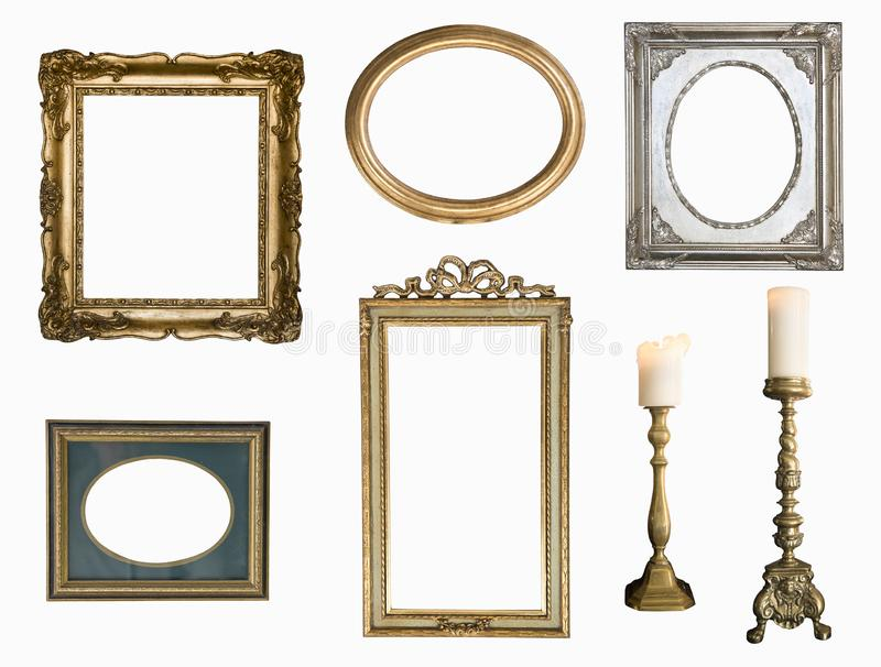 Set of golden vintage frame adn candlesticks isolated on white background. royalty free stock images