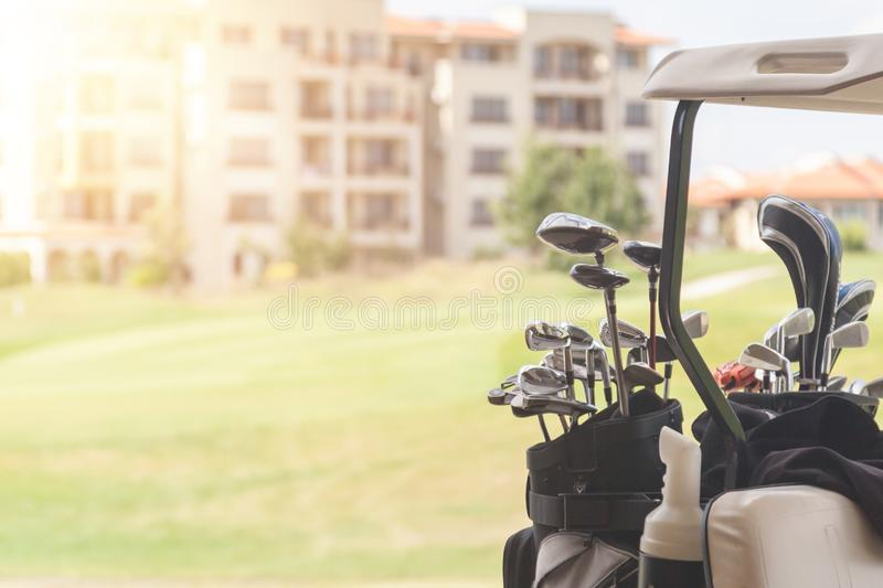 Set of golf clubs on golf cart on a golf course stock photo