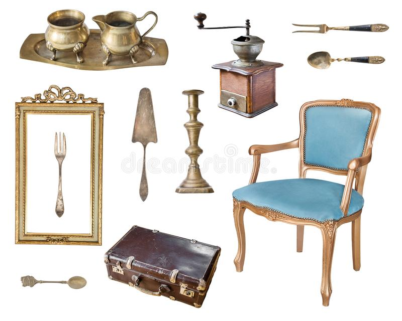 Set of 13 gorgeous old vintage items. Antique slul, coffee grinder, milk jug, sugar bowl, frame, suitcase, candlestick, cutlery. royalty free stock photo