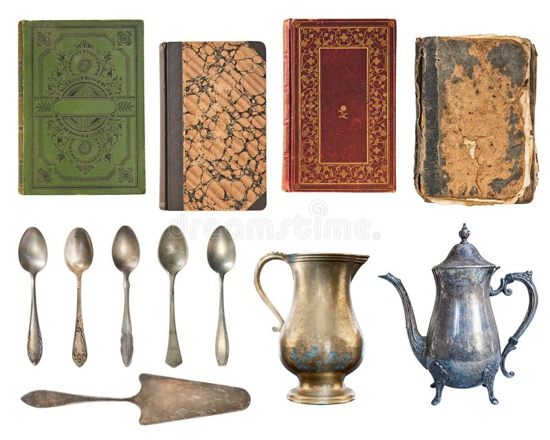 Set of 12 gorgeous old vintage items. Vintage books, teaspoons, vintage metal kettles and cake spatula. Isolated on white royalty free stock image