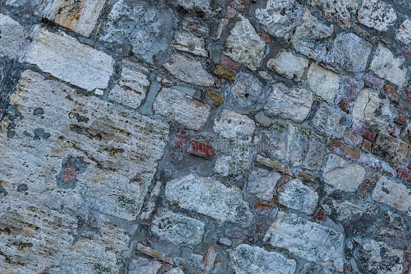 Set gray stones large small fort wall surface weathered corrosion powerful protection base urban stock photography