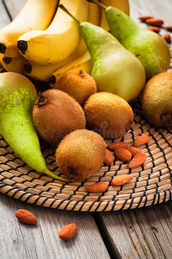 Set of green and yellow fruit on wooden background royalty free stock images