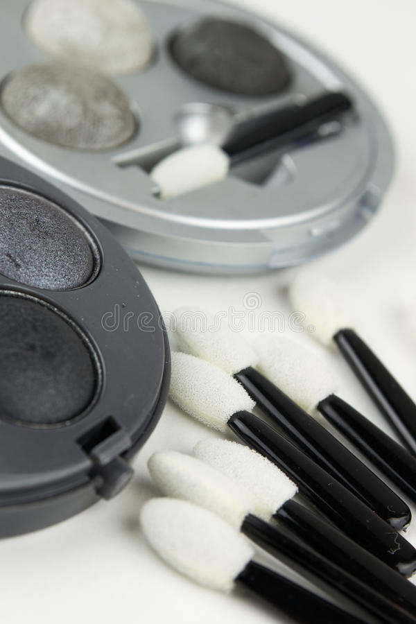 Set of grey eye shadow and applicator brushes. Close up stock photos