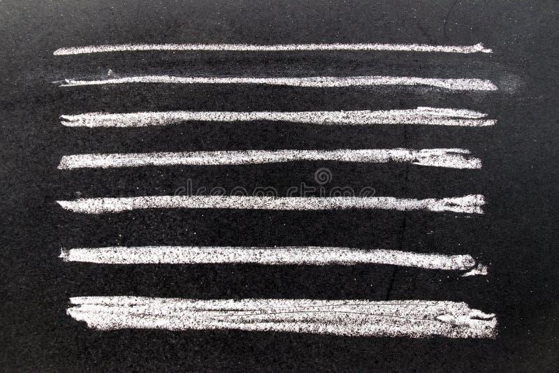 Set of grunge white chalk art brush in square line shape on black board background. Decoration and design element royalty free stock photo