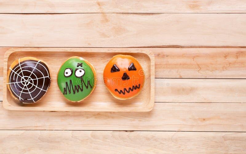 Set of halloween donuts. Halloween sprinkles, green zombie, pumpkin, spider web set of halloween donuts background stock images