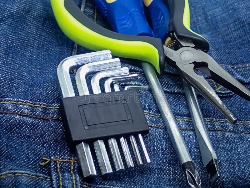 Set of hand tools construction repair technique pair of screwdrivers cross flat knives hexagon duck key close-up stock image