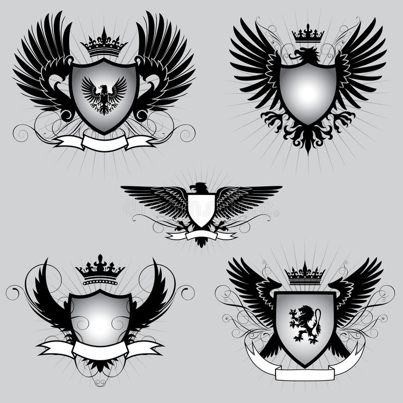 Set heraldyki oskrzydlona osłona ilustracja wektor