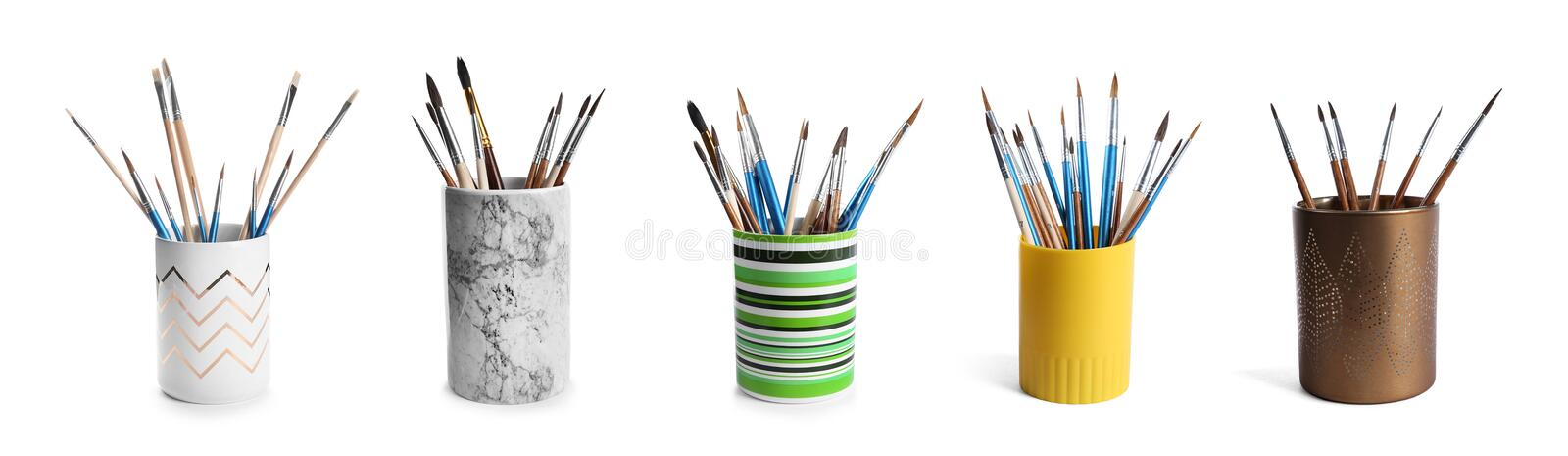Set of holders with different paint brushes stock image