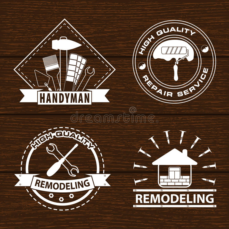 Set of house renovation labels and home remodeling logos. Handyman logo on wooden background. royalty free stock photography