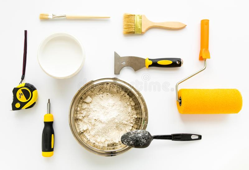 Set of house repair constructing and painting equipment on white background. Flat lay. Set of house repair constructing and painting equipment on white royalty free stock photo