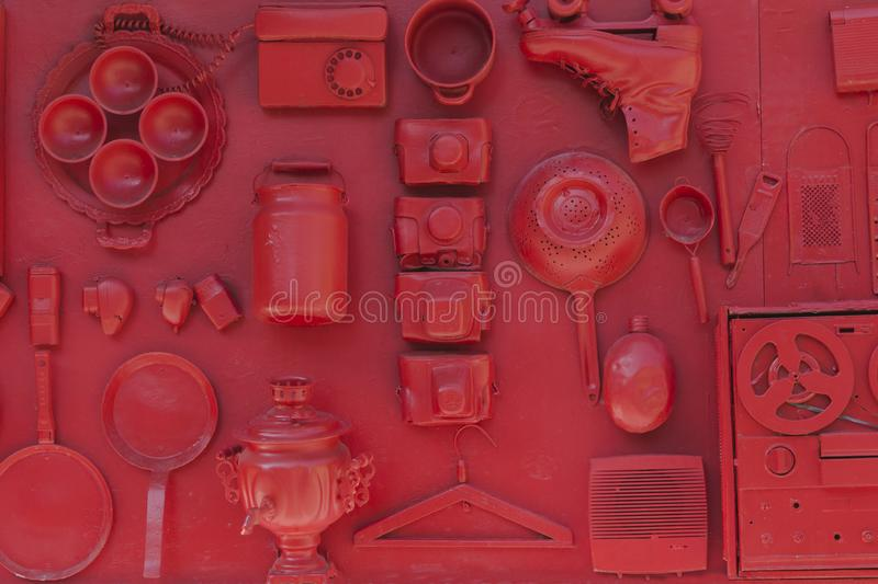 Set of household items of the 20th century, retro collection on the red wall.  royalty free stock photos