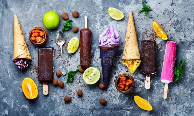 Chocolate and fruit ice cream. Set of ice cream of different colors and flavours.Assorted ice cream stock image
