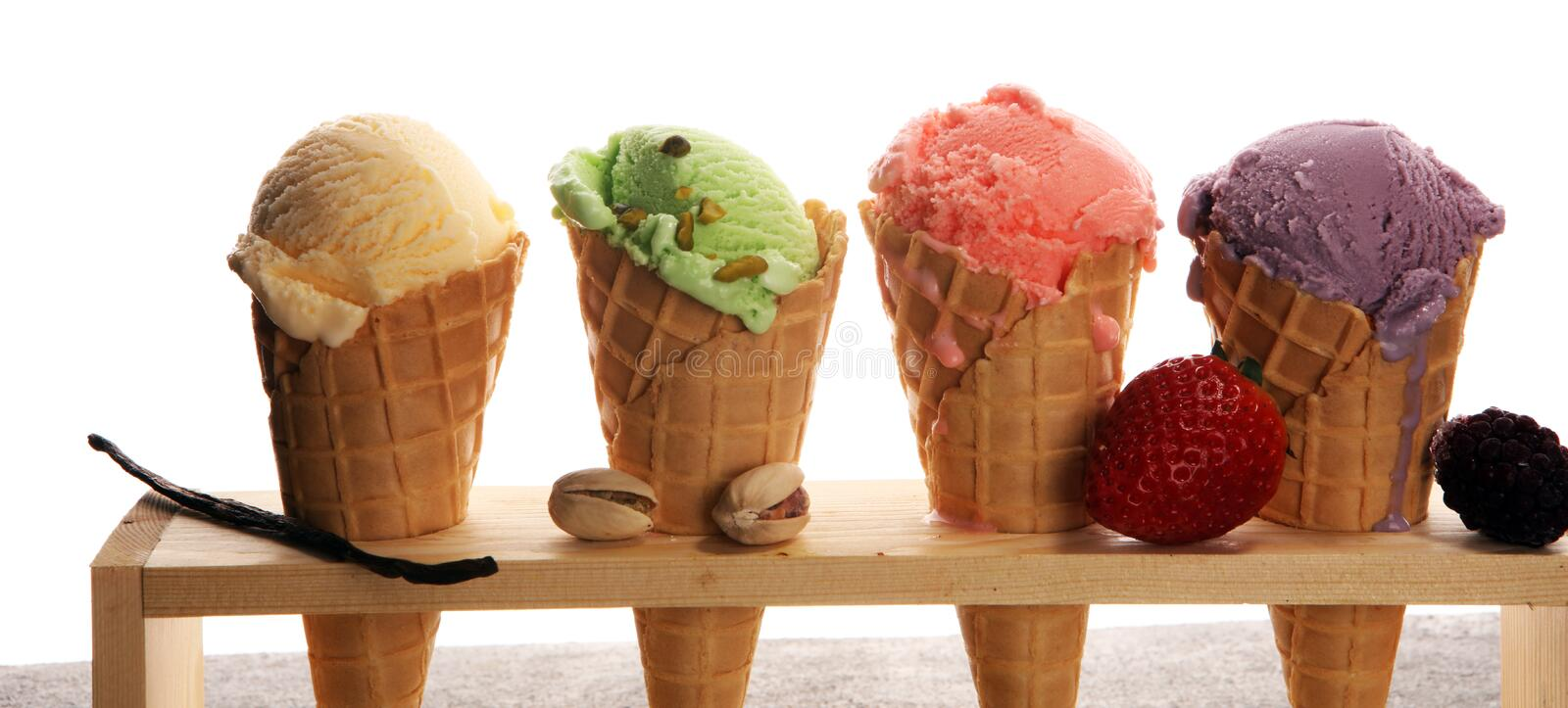 Set of ice cream scoops of different colors and flavours. With berries, nuts and fruits and vanilla stock photography