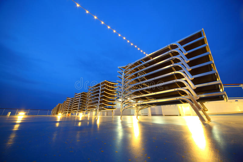Download Set Of Illuminated Deck-chair Stack On Ship Deck Stock Image - Image: 17215159