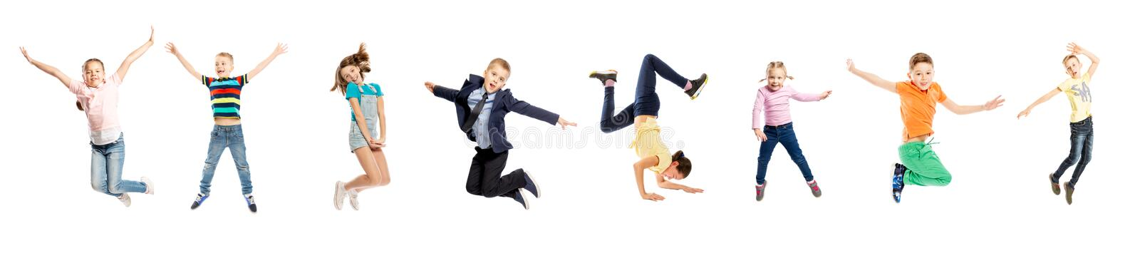 Set of images of jumping children of different sex and age. Isolated over white background. stock photos