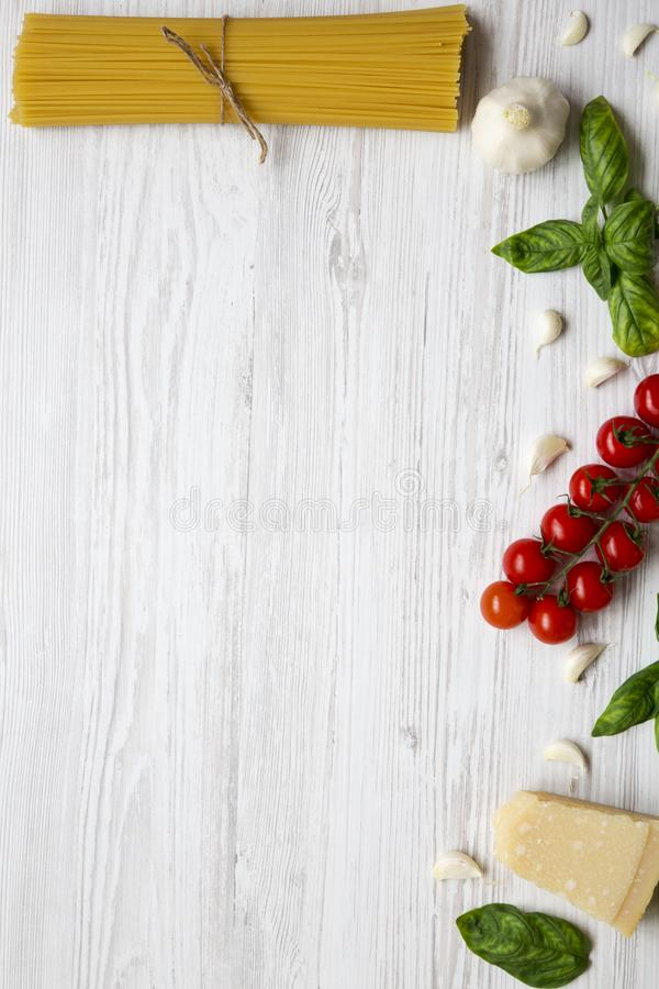 Set of ingredients for cooking pasta on a white wooden background. Top view. royalty free stock photos