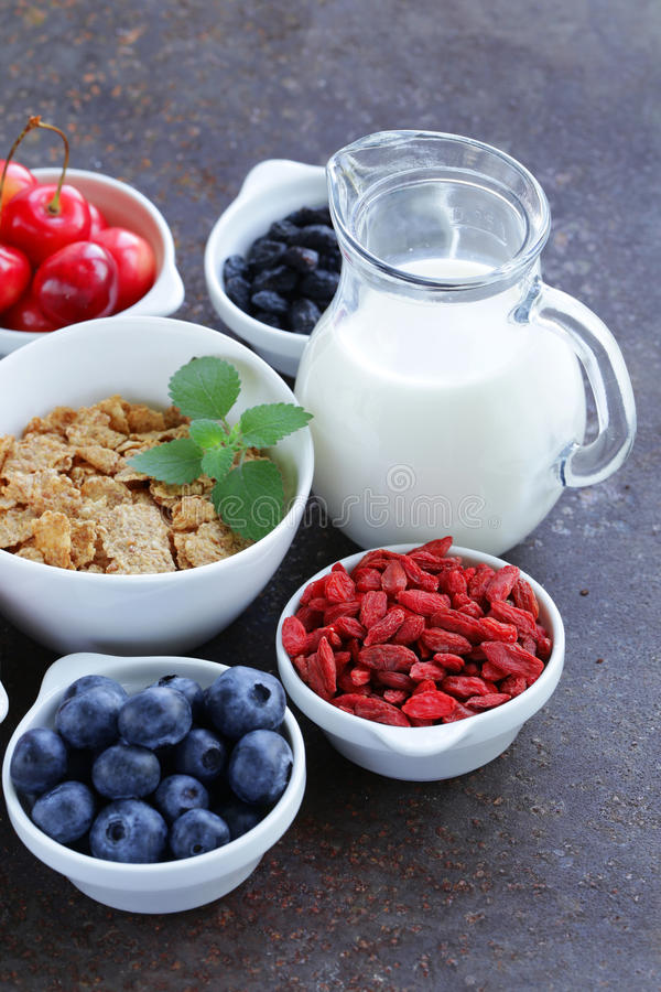 Set of ingredients for a healthy food breakfast - muesli, fresh and dried fruit, nuts, goji royalty free stock photo