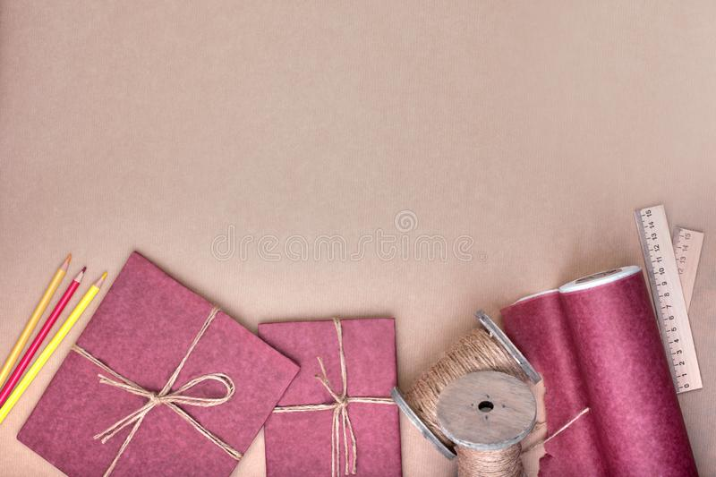 Gift wrapping set on pink. A set of items for gift decoration. Flat lay top view stock image