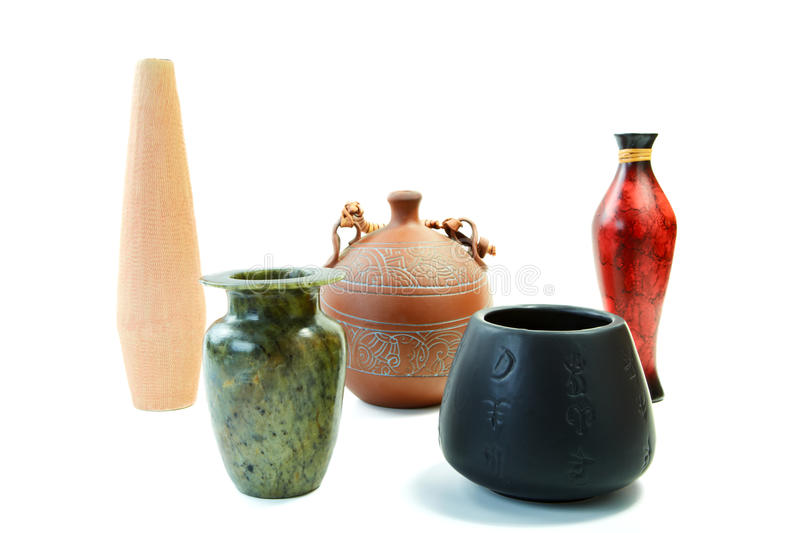 Set from jugs and vases on a white