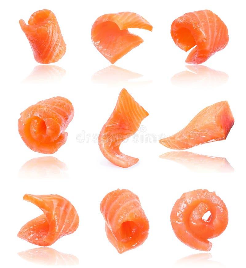 Set of juicy slices of salmon isolated on white background stock photos