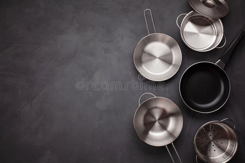 Set of kitchen metallic pans. Mockup, kitchen utensils, recipe b royalty free stock images