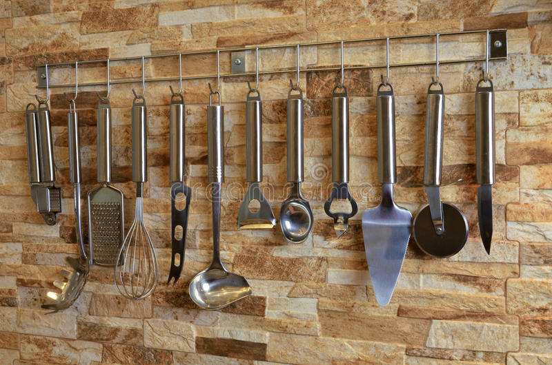 Download Set Of Kitchen Utensils Hanging On The Wall Stock Photo   Image Of  Utensil,