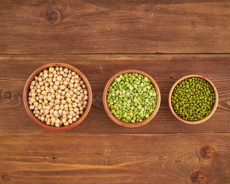 set of legumes, beans for gluten-free protein vegan diet, green peas, chickpea, mung, top view stock images