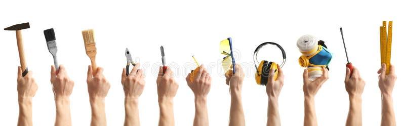 Set mężczyźni trzyma różnych budów narzędzia na białym tle zdjęcie stock