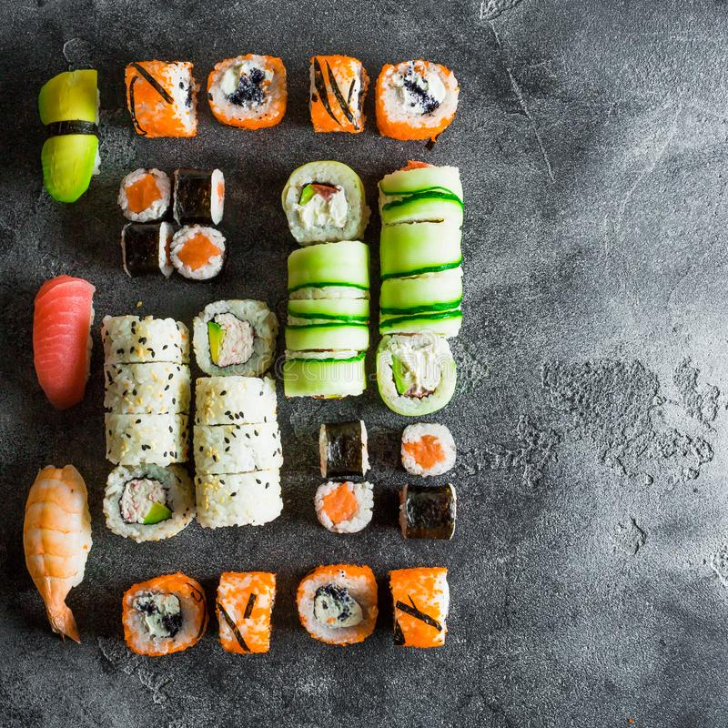 Set made of sushi rolls on a grey background. Japanese food. Flat lay stock image