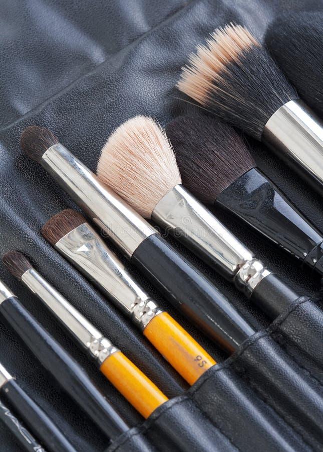 Set of make-up artists brushes stock photo