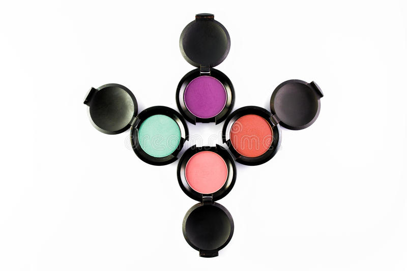 Set of 4 Make-up colourful eye shadows isolated on a white background. royalty free stock photography