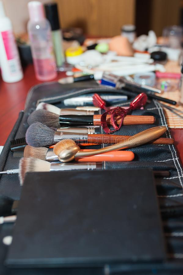 Set of makeup brushes, brushes for cosmetics of different sizes. overview of tools of a makeup artist. opening palettes of brushes stock images