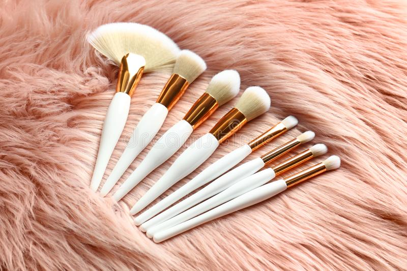 Set of makeup brushes on faux. Fur royalty free stock image