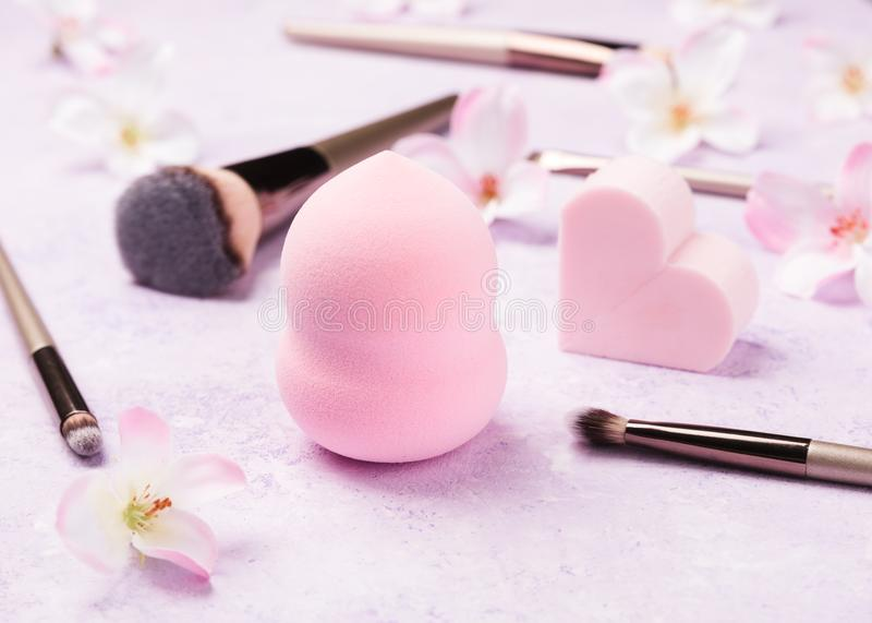 Set of makeup brushes on pink background. stock photo