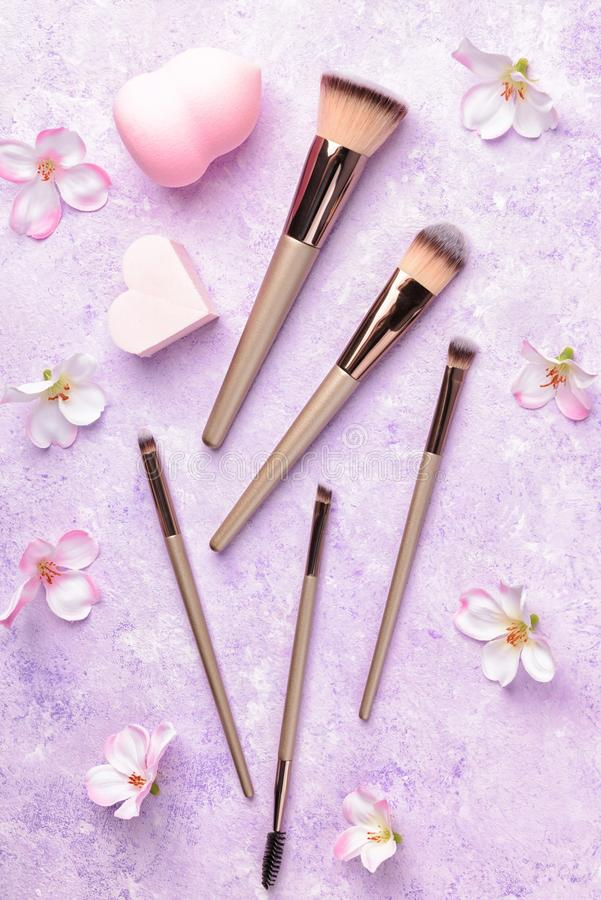 Set of makeup brushes on pink background. royalty free stock photos