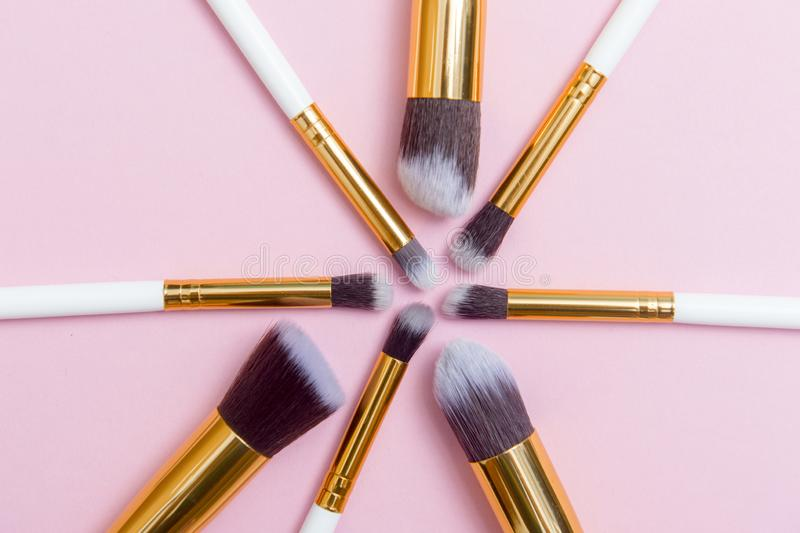 Set of makeup brushes on pink background. Top view point, flat lay. Top view royalty free stock image