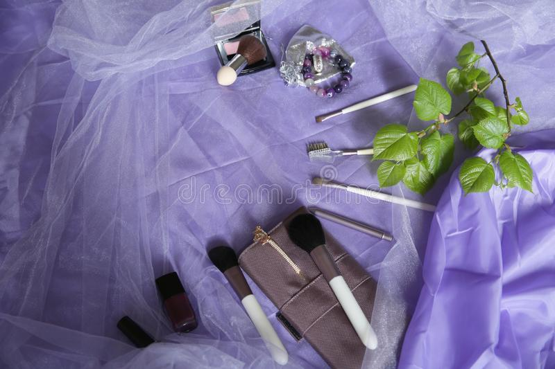 Set of makeup brushes, professional make-up tools, brushes for various functions, blush and varnishes. Women`s fashion accessories royalty free stock photography
