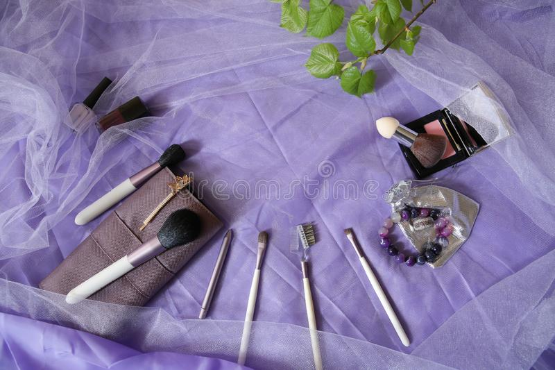 Set of makeup brushes, professional make-up tools, brushes for various functions, blush and varnishes. Women`s fashion accessories royalty free stock image