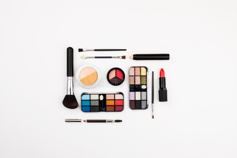Set of makeup cosmetic: shadows, brushes, lipstick on a white background, top view, flatlay composition. Cosmetics, beauty, fashion, female, glamour, mascara stock images