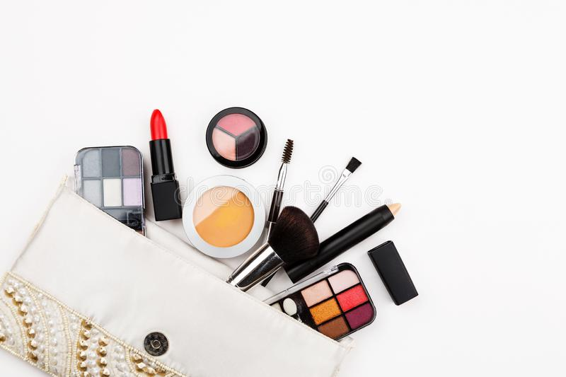 Set of makeup cosmetic: shadows, brushes, lipstick on a white background, top view, text space stock image