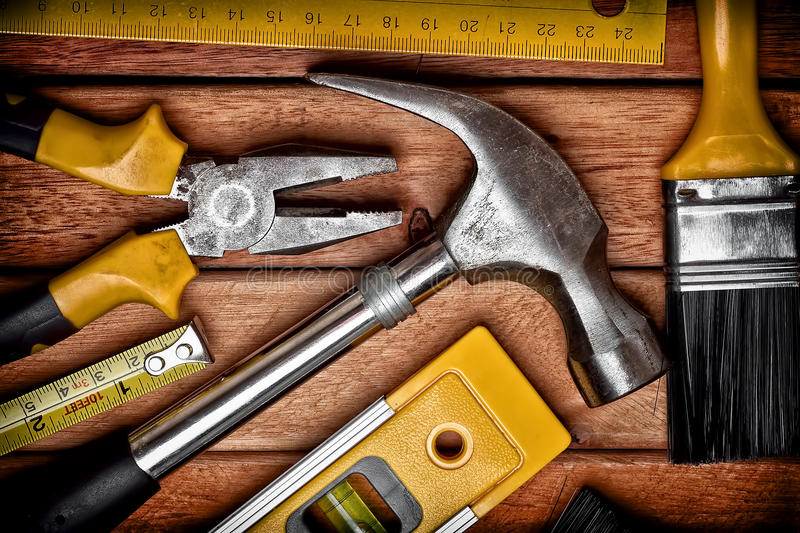 Set of manual tools on a wooden floor royalty free stock photos
