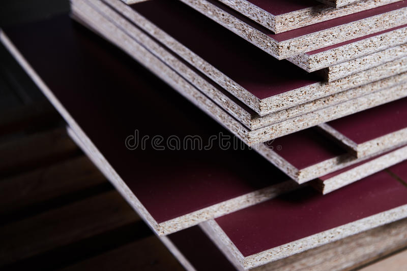 Set in the manufacture of chipboard. In low light stock images