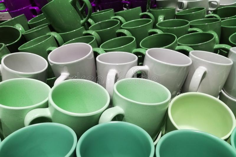 Set of many empty cups different colors abstract background. Set of many empty cups different colors abstract stock photo