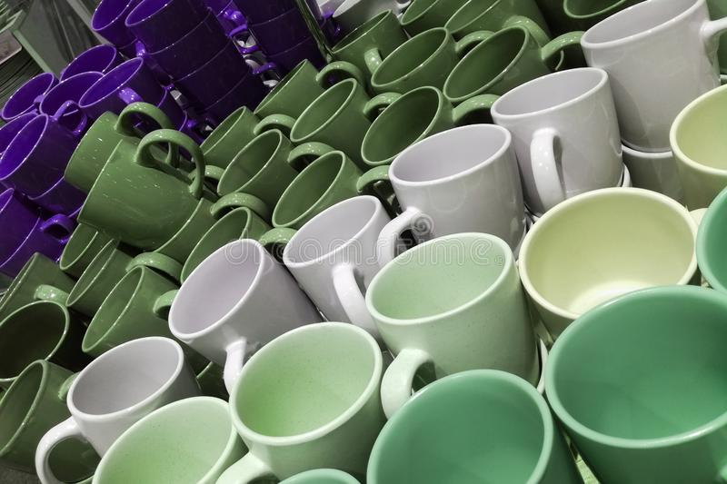 Set of many empty cups different colors abstract background. Set of many empty cups different colors abstract royalty free stock photography
