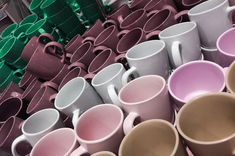 Set of many empty cups different colors abstract background. Set of many empty cups different colors abstract stock photos