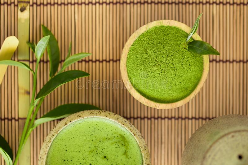 Set of matcha powder bowl wooden spoon and whisk green tea leaf Organic Green Matcha Tea ceremony stock photography