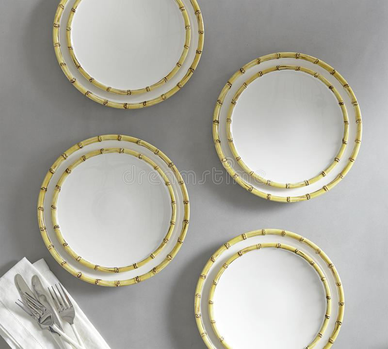 Set of 4 matching decorative plates for interior design - yellow waves. royalty free stock images