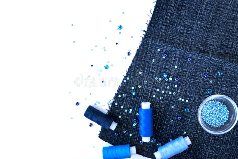 A set of materials for needlework in blue color stock images
